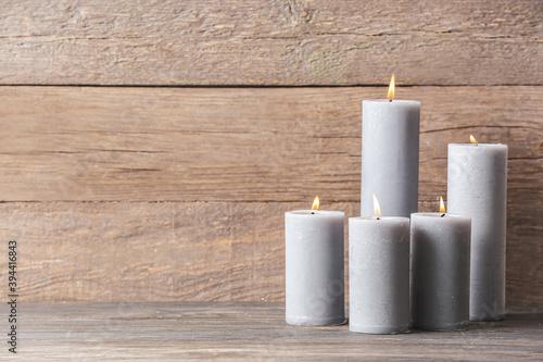Fototapeta Beautiful aroma candles on wooden background