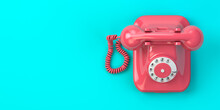 Pink Vintage Rotary Telephone On Mint Green Background.
