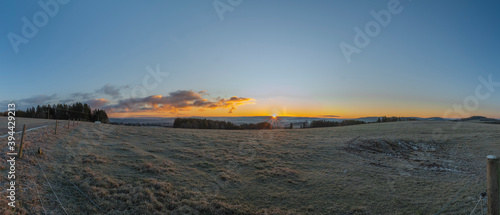 Fotografia, Obraz Rybnik village with pasture land in frosty color morning in sunrise time