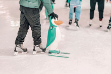 Ice Rink. Abstract Boy Holds A...