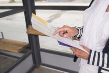 Woman Holding Leaflet, Sweden