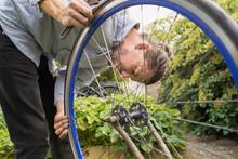 Repairing Bicycle Wheel, Sweden