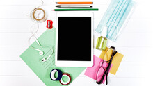 Study At Home Concept! Top View Flat Lay Style Image Workspace Student College School Supplies. Tablet Pc Gadget On Desk, Face Disposable Blue Mask Coronavirus, Antiseptic. Remote Education. Mock Up