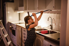 Girl Dismantling Kitchen Cupboards, Sweden