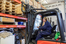Woman Driving Forklift Truck I...