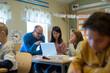 Teacher helping girls in classroom, Sweden
