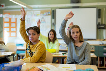 Children Raising Hands In Classroom, Sweden