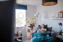 Woman Watching TV In Living Ro...