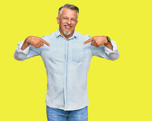 Middle Age Grey-haired Man Wearing Casual Clothes Looking Confident With Smile On Face, Pointing Oneself With Fingers Proud And Happy.