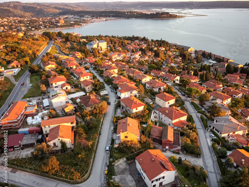 Obraz aerial drone view village at seaside with red roofs - fototapety do salonu