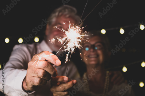 Papel de parede cute couple of two senior in love together the new year night playing with the s