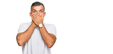 Middle Age Handsome Man Wearing Casual White Tshirt Shocked Covering Mouth With Hands For Mistake. Secret Concept.