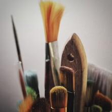 Close-up Of Paintbrushes Against Gray Background