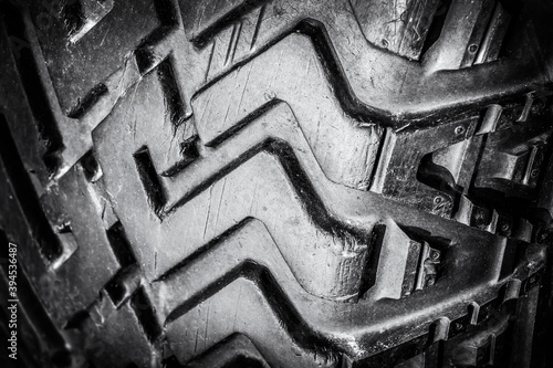 Tread old car tires for off-road close-up. Black and white photo.