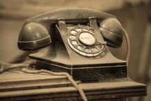 Close-up Of Old Telephone On Table