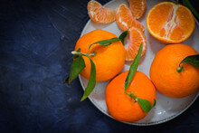 Tangerines On A Bright Plate A...