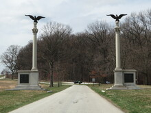 Looking Down A Road With The Pennsylvania Columns On Each Side In Valley Forge National Historical Park