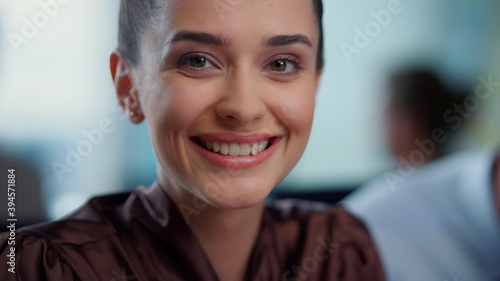 Young businesswoman laughing at camera.Smiling female employee looking at camera - fototapety na wymiar