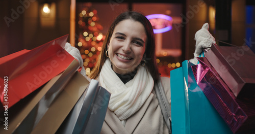 Cheerful happy woman doing Christmas shopping Fototapet