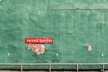 Private Parking Sign On Green Wall