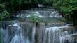 4K of Huay Mae Khamin waterfalls in deep forest at Srinakarin National Park ,Kanchanaburi ,A beautiful stream water famous rainforest waterfall in Thailand