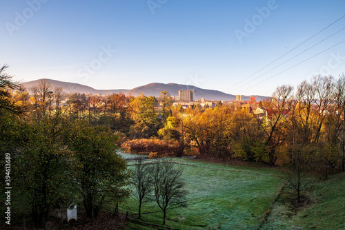 Fototapeta Trinec town with Maly Javorovy and Ostry hills on the background in Czech republic during autumn morning obraz