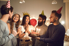 Group Of Friends Giving Birthd...