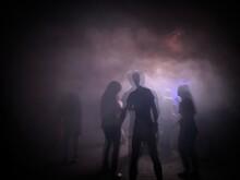 Silhouette People Dancing In Smoke At Nightclub