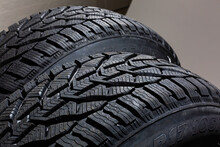 Two Black Tires On The Gray Background