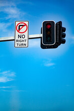 No Right Turn Sign On Red Traffic Signal Light