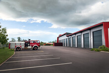 Single Fire Truck Parked Outside Large Modern Shed
