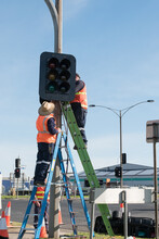 Workmen Repairing Traffic Signals
