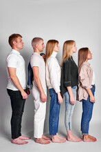 Side View On Group Of Youth Standing In A Row In Descending Order, Beautiful People In Casual Wear Posing, People Diversity Concept