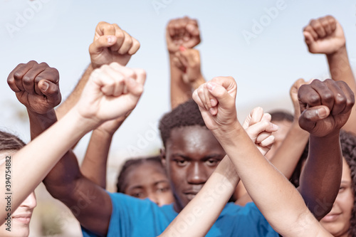 People raised fist air fighting for their rights Fototapet