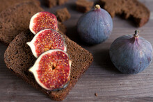 Bunch Of Fresh Ripe Figs On Wo...