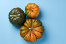 Small Pumpkins On Blue Pastel Background Top View