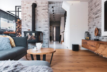 Stylish Living Room Interior With Wooden Floor, Brick Wall And Fireplace