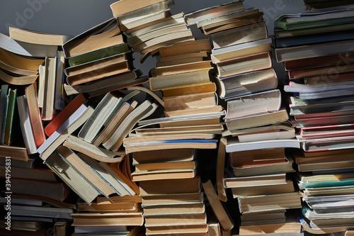 Fototapeta Pile of old books in dramatic dim light in the attic obraz