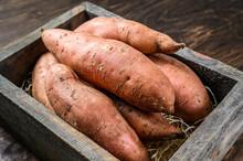 Raw Batata Sweet Potato On Woo...