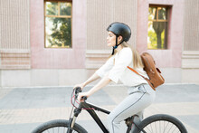Profile Of A Businesswoman Riding A Bike To Work