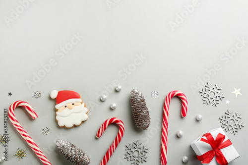 Fototapeta Flat lay composition with candy canes and Christmas decor on grey background. Space for text obraz