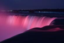Scenic View Of Illuminated Niagara Falls At Night