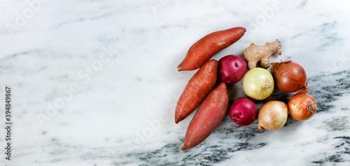 Fotografia Fresh raw organic vegetables on marble stone table