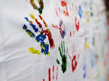 Close-up Of Colorful Handprints On Fabric