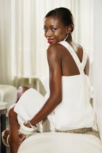 Portrait Of African Woman Looking Over Shoulder