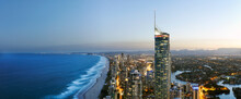 Panorama Aerial Of Surfers Paradise And Surrounding Suburbs Early Evening With Light On In Buildings