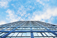 Looking Up At Mirrored Glass Side Of High Rise Building