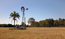 Windmill Creating Energy To Run Water Pump On Rural Property