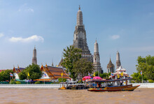 Tour Boat And Jetty On Chao Phraya RIver Next To Wat Arun Buddist Temple