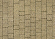 Seamless texture of street tiles.  Pattern of yellow paving slabs made of granite chips.